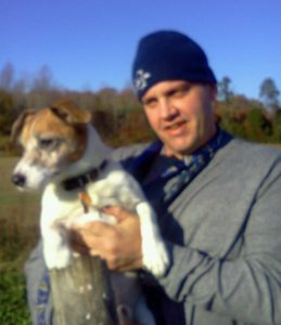 Photo of Brian Vaillancourt holding a terrier dog